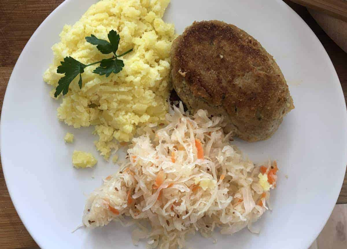 Pork cutlets with mashed potatoes and salad.