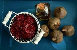 Buraczki in a bowl surrounded by beetroots.
