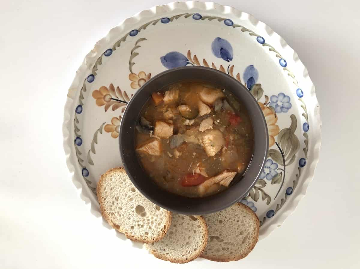 Beef strongaoff with bread in a plate.