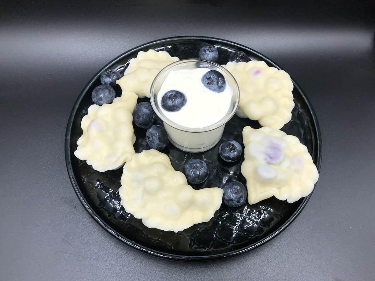 blueberry pierogies with sour cream.
