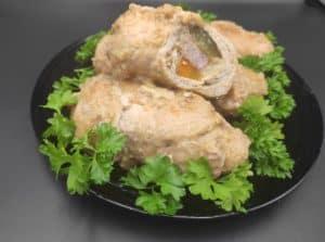 Roladki Wieprzowe Polish meat rolls in a black plate.