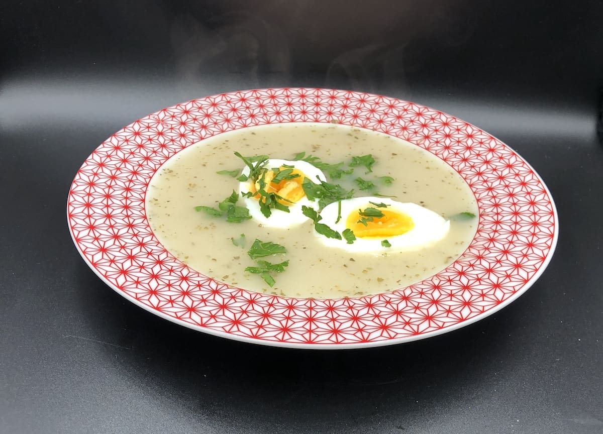 Serve the Polish White Borscht with hard boiled eggs.