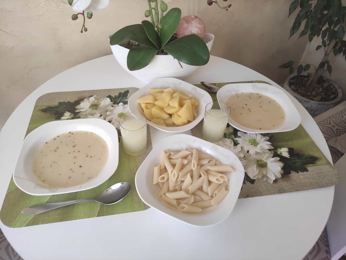 A table set with Polish white borscht.