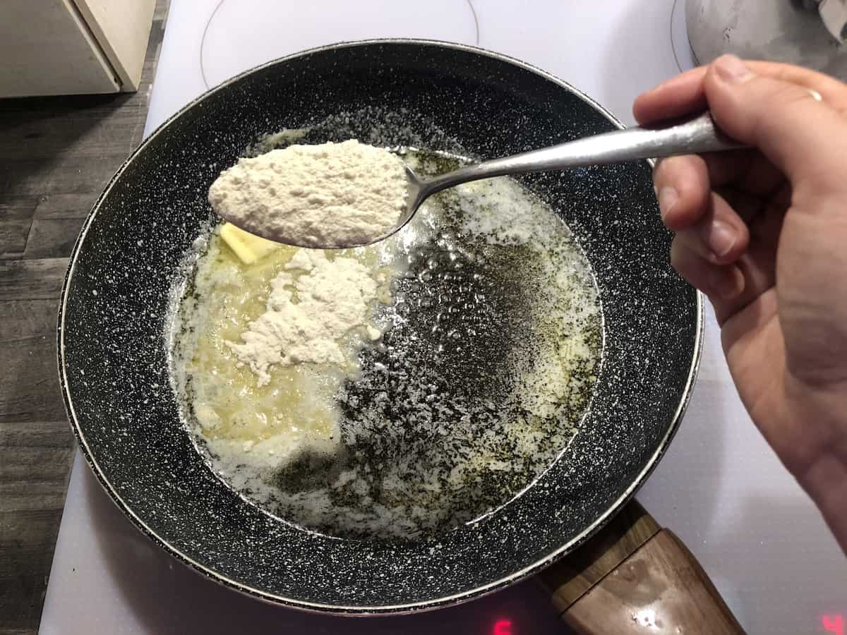 Add flour to the melting butter.