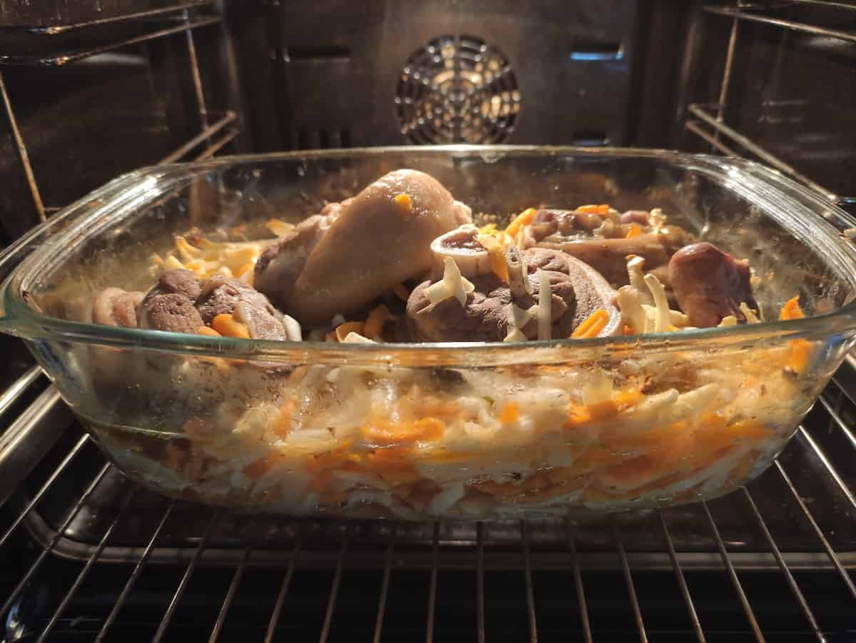 Pork knuckle cooking in the oven.