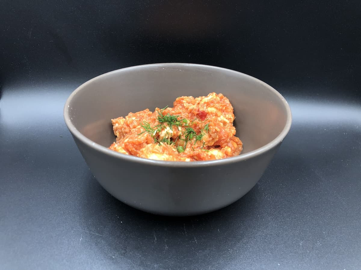Chicken In Creamy Tomato Sauce in a grey bowl.