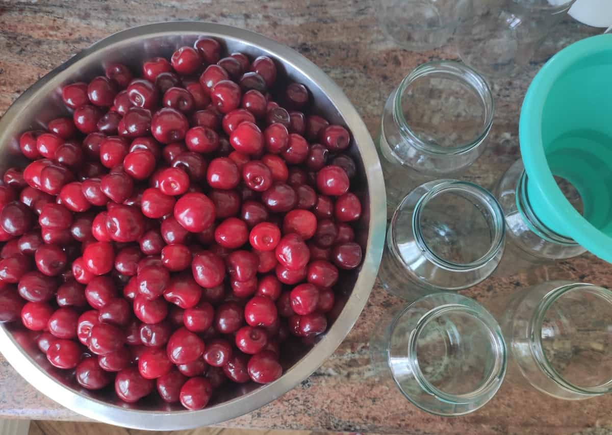 Cherries and glass jars.