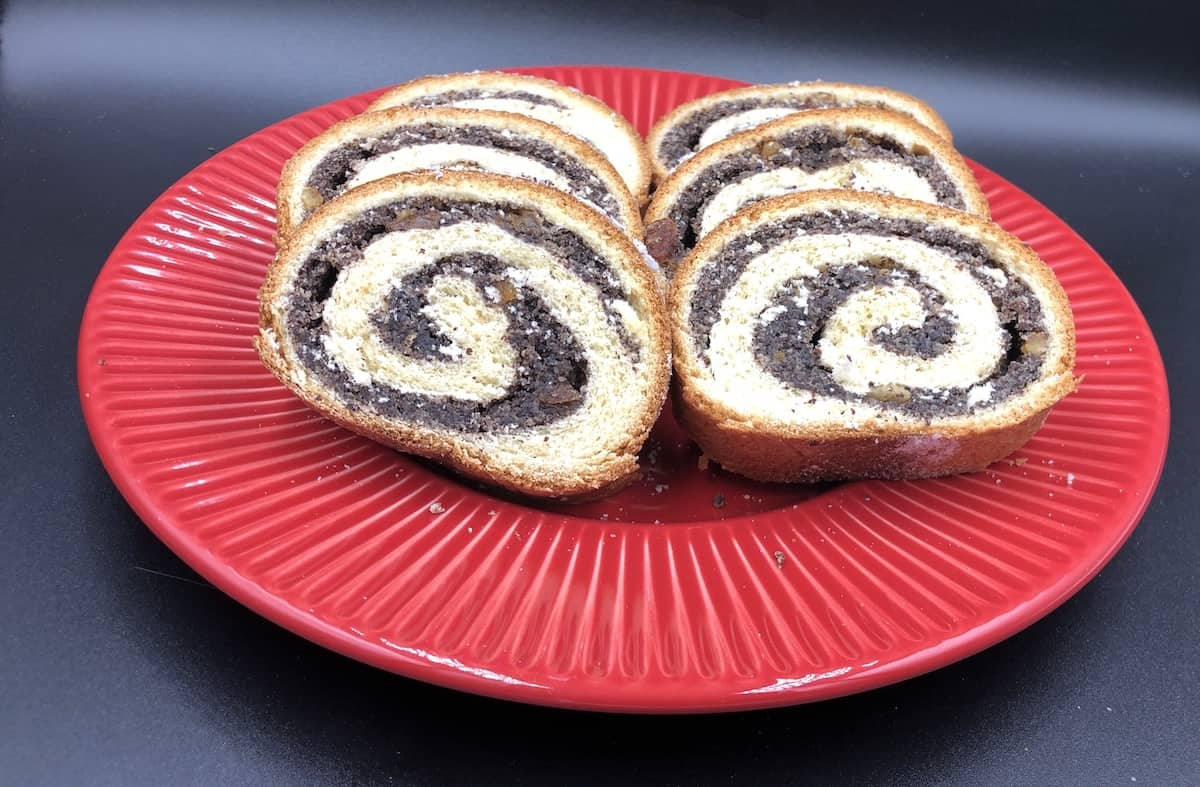 Makowiec Roll in a red plate.