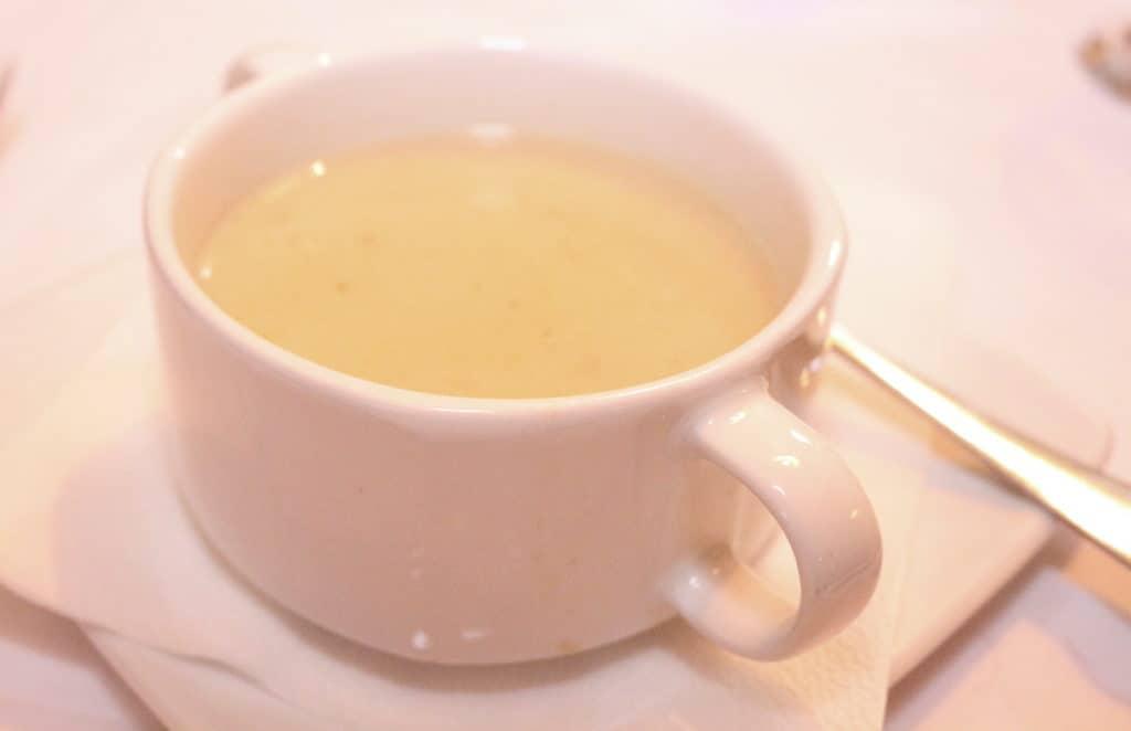 Soup Zalewajka in a white cup.