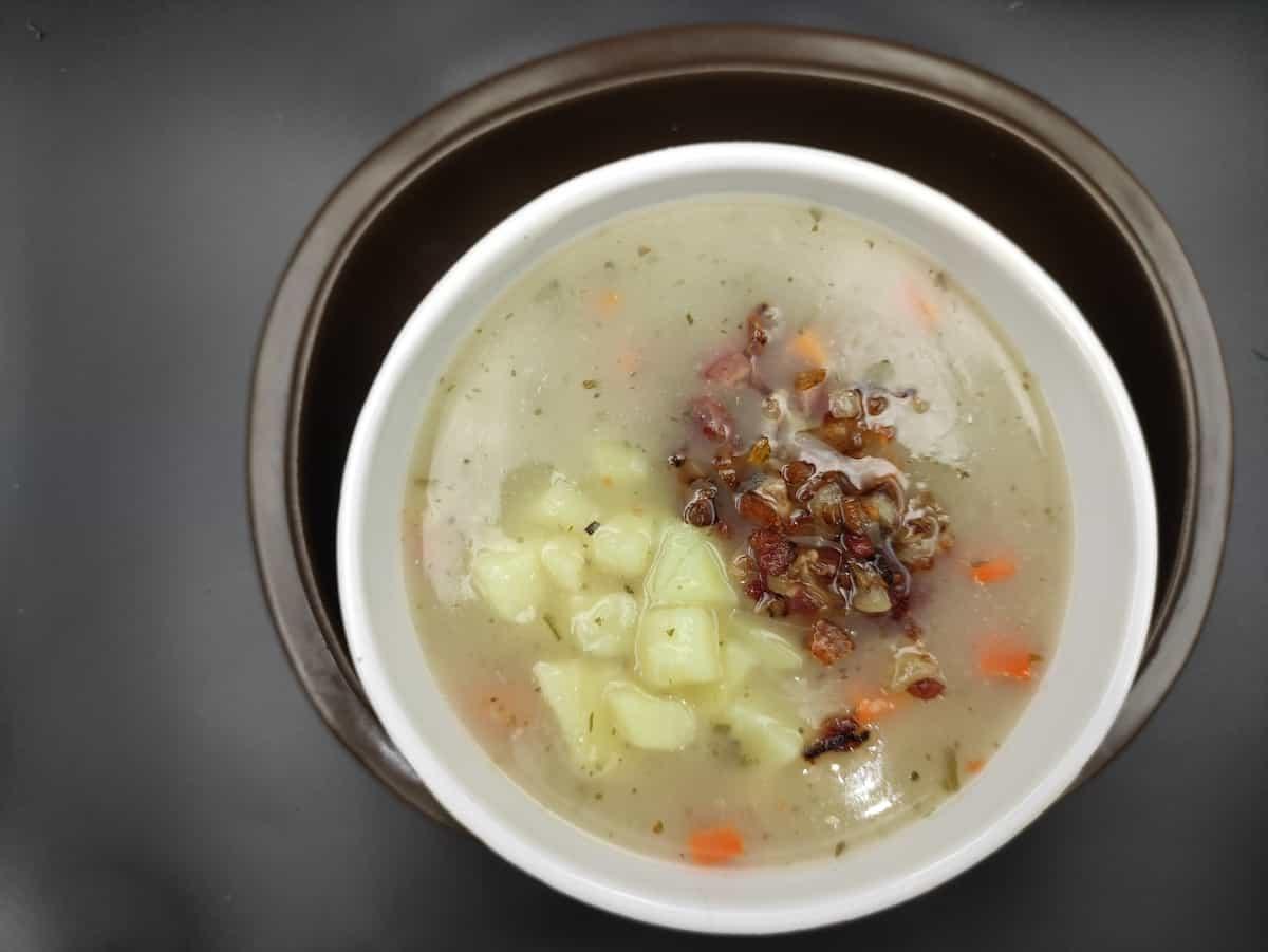 Polish vegan zurek in a white bowl.
