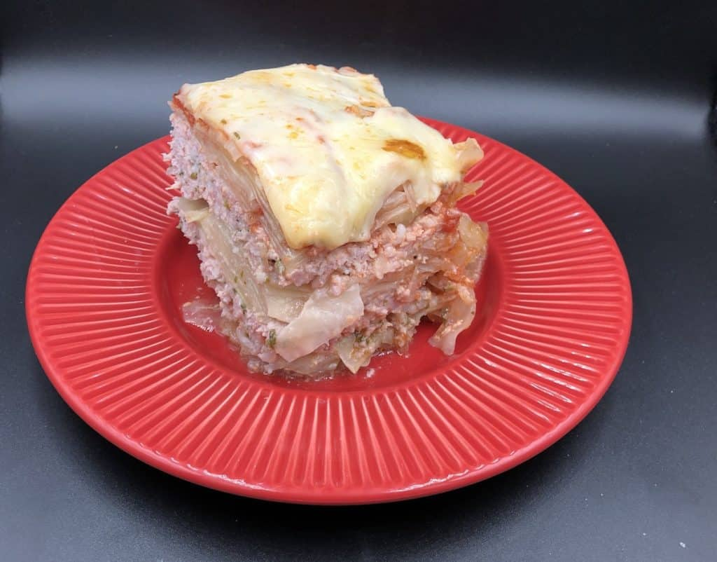 Polish lasagna in a red plate.