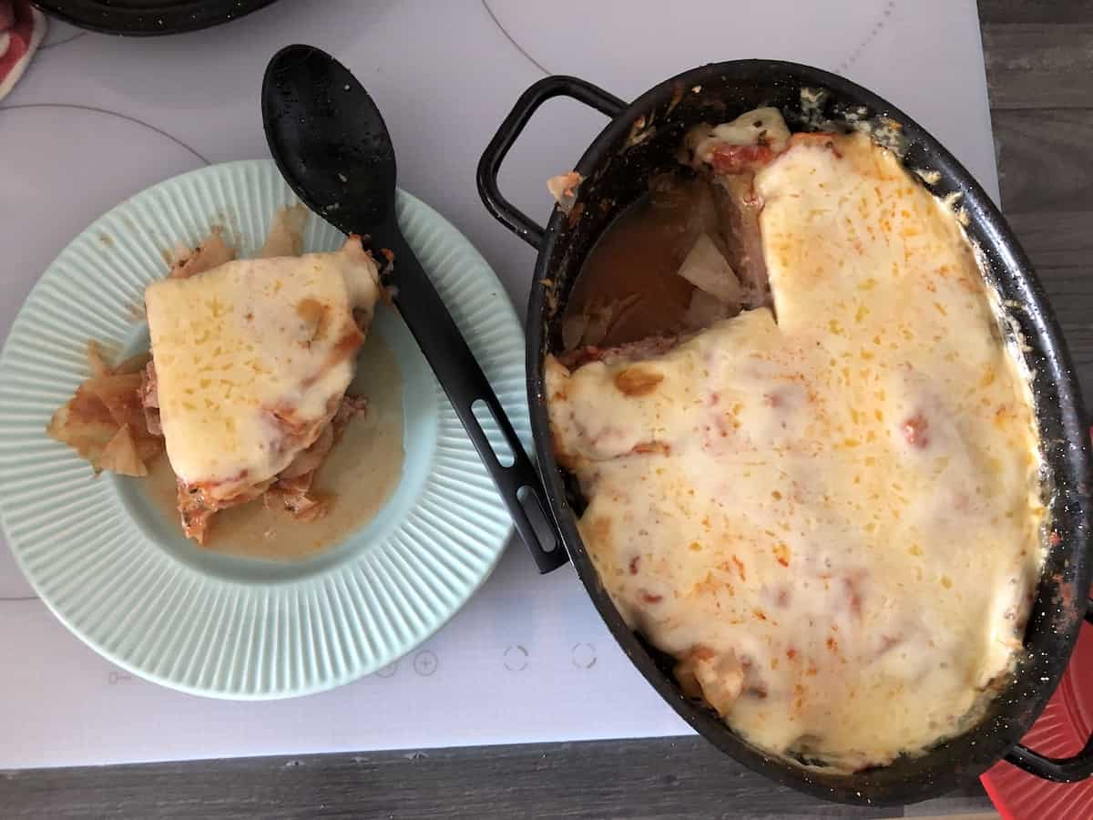 polish lasagna topped with cheese.