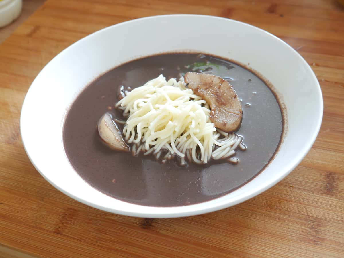 Polish duck blood soup in a white bowl.
